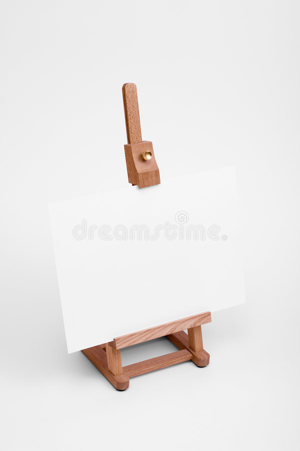 Art easel with white card. stock image