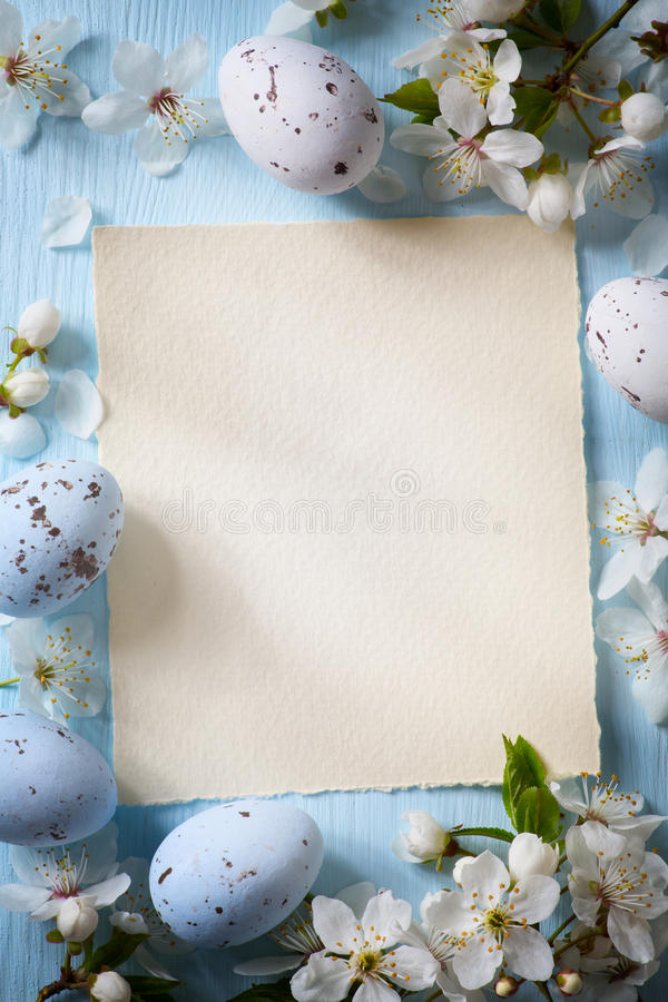 Art Easter eggs and spring flowers on wooden background stock photo