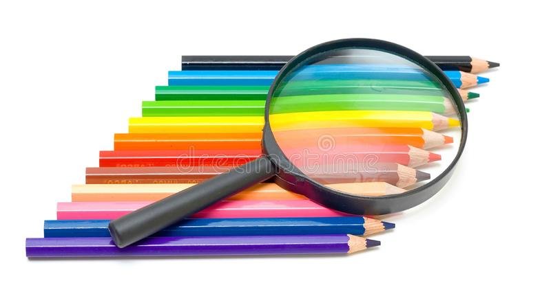 Art education concept - pencils and glass royalty free stock photos