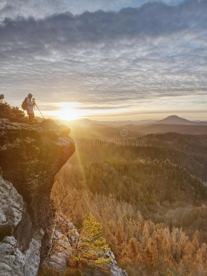 Art enthusiast with tripod on cliff. Peak with woman taking photos royalty free stock image