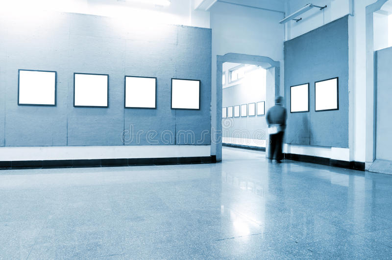Art exhibition hall. A man looking at the exhibition,Concentrate royalty free stock photo