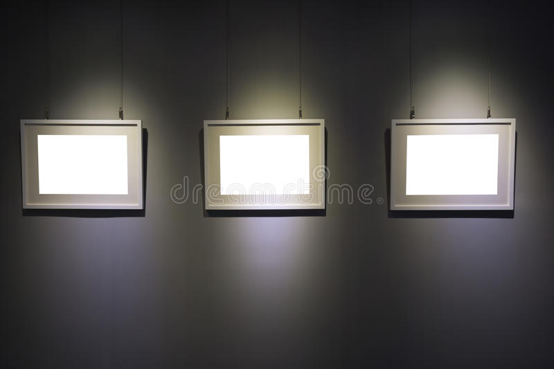 Art exhibition. With picture frame and spotlight stock image