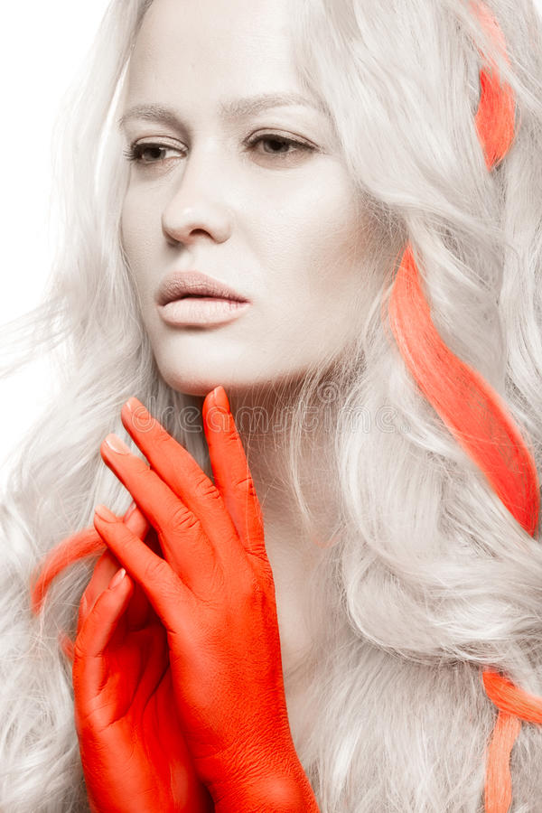 Art fashion girl with white skin in form of albinos, red arms and lock hair. Creative beauty image . royalty free stock images