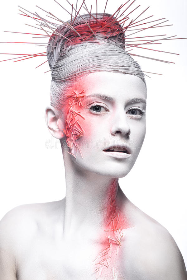 Art fashion girl with white skin and red paint on. The face. Creative art beauty. Picture taken in the studio on a black background royalty free stock photography