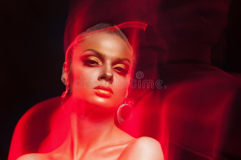 Art fashion make up photo. Woman with fire type flames arround h royalty free stock image