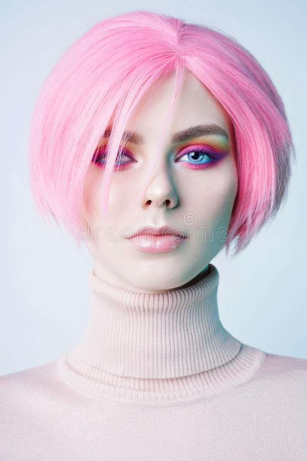 Art fashion studio portrait of beautiful redhead woman with modern makeup stock image