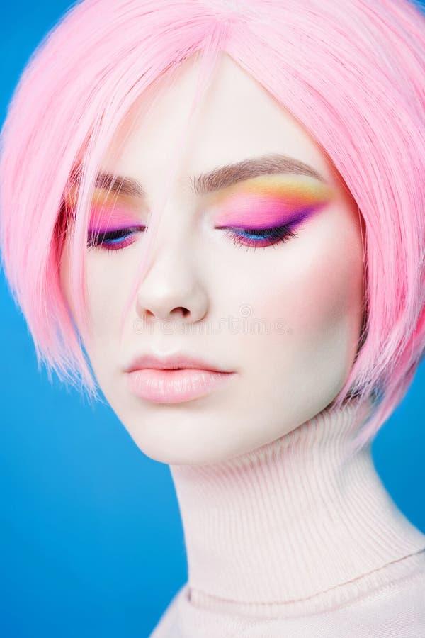 Art fashion studio portrait of beautiful redhead woman with modern makeup royalty free stock photo
