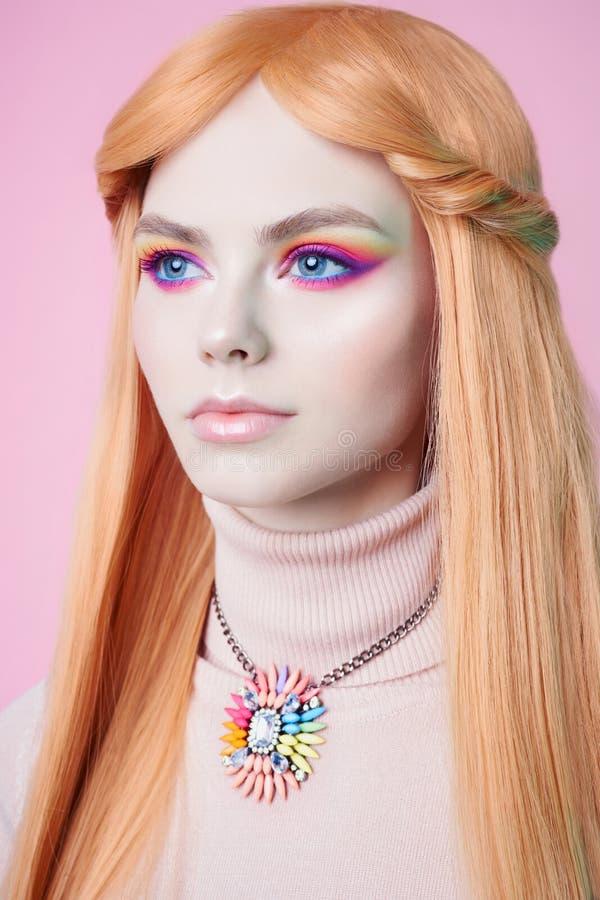 Art fashion studio portrait of beautiful redhead woman with floral jewelry stock photo