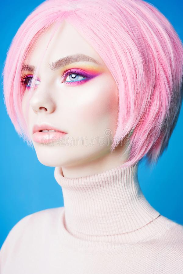 Art fashion studio portrait of beautiful redhead woman with modern makeup stock photo