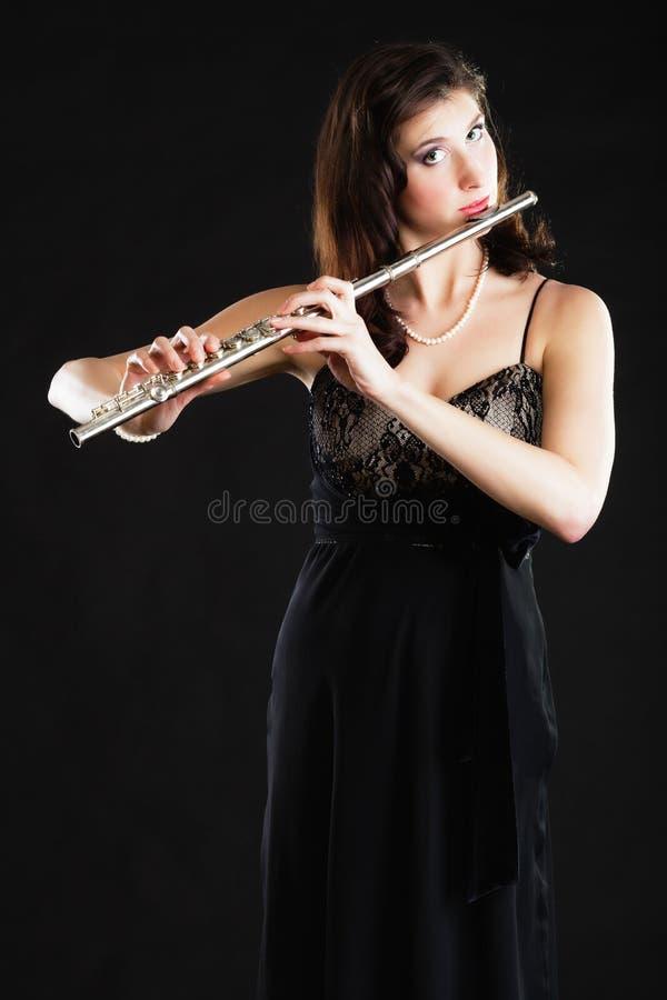 Art Flaustistmusicus van de vrouwenfluitist het spelen fluit royalty-vrije stock afbeelding