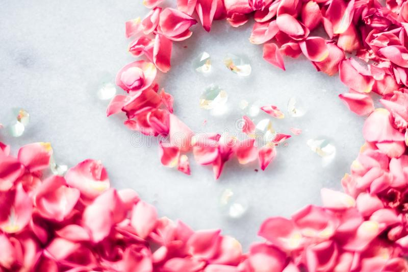 Rose petals on marble stone, floral background royalty free stock photo
