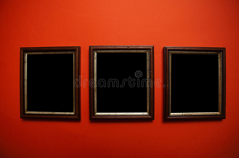 Art frames on red wall royalty free stock photo