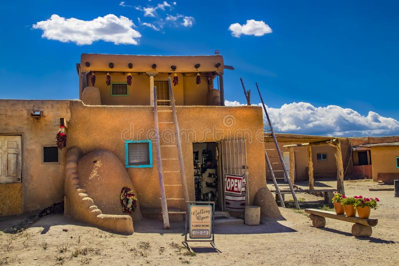 Art gallery open at the ancient adobe Taos Pueblo where indigenous people have lived for over 1000 years - door standing open and stock photo