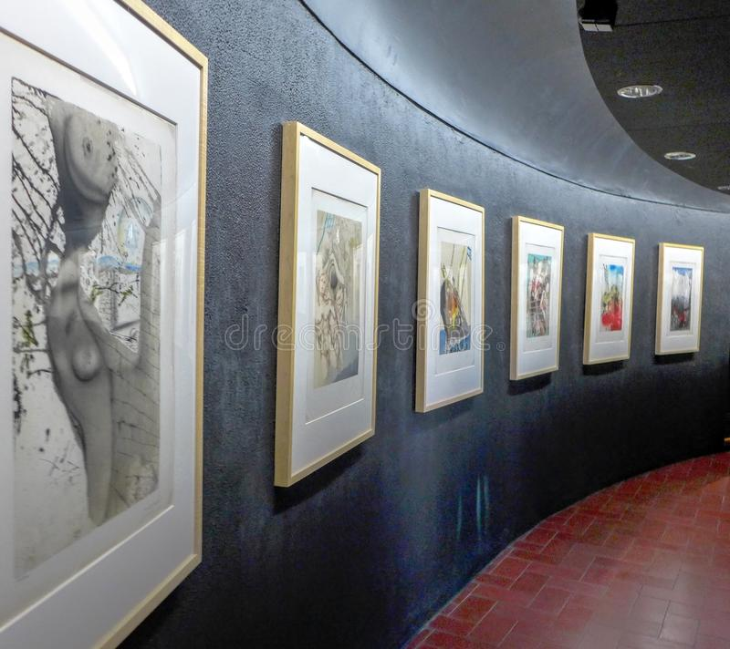 Art gallery in Spain. Pictures on the grey wall in the art gallery royalty free stock images