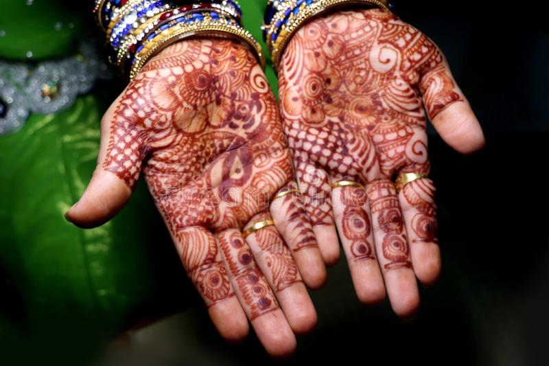 Art in girls hand using henna plant also called as mehndi design,style. It is a tradition in india royalty free stock photography