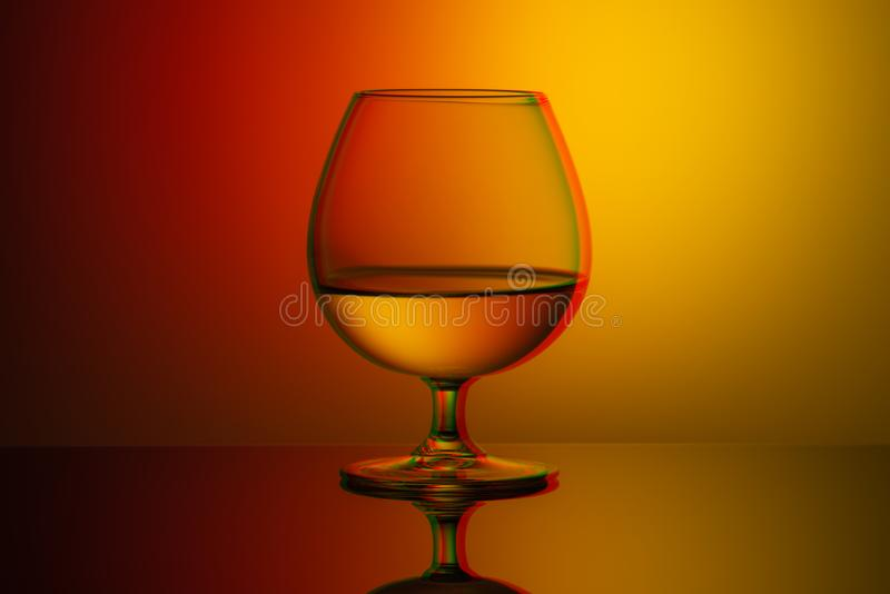 Art glitch effect, glass glass with water on a bright multi-colored background, minimalism. Art glitch effect, glass glass with water on bright multi-colored royalty free stock images