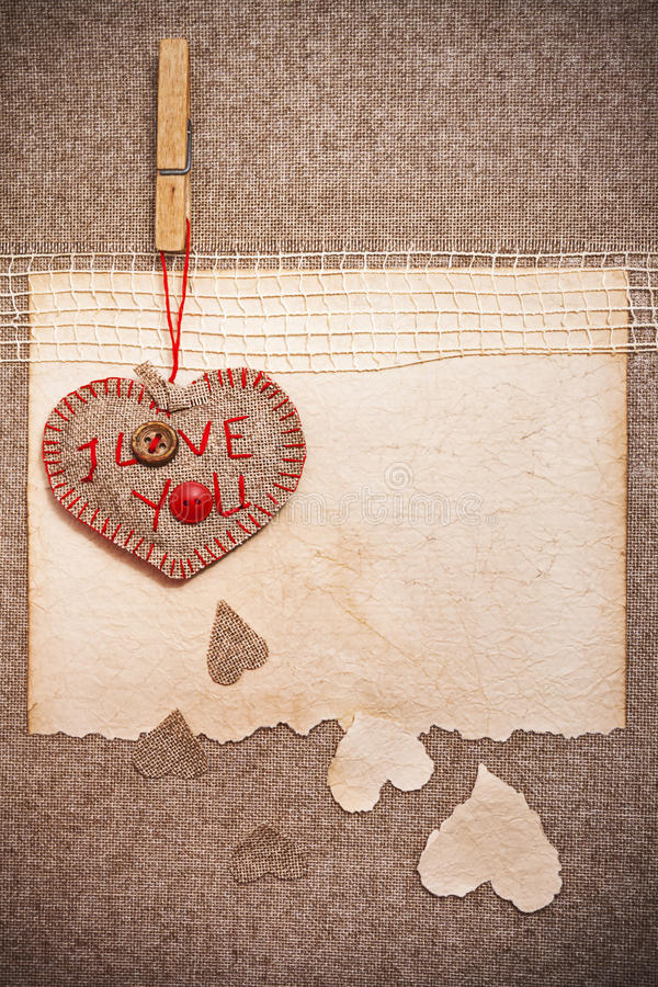 Art greeting card on vintage background with heart, old paper, f stock photography