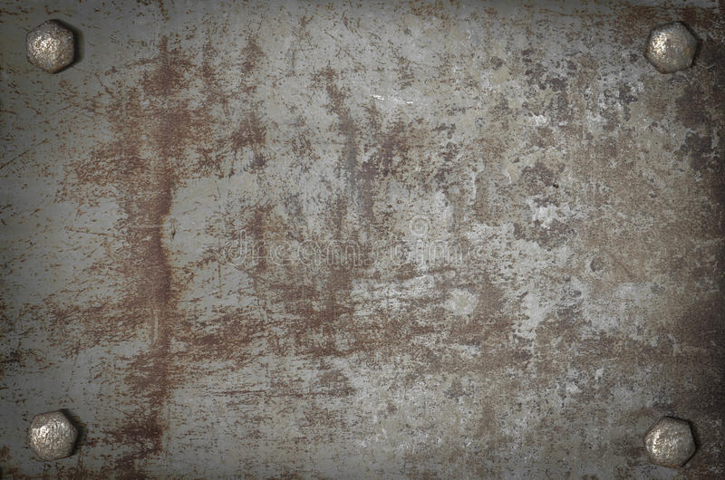 Art grunge metal plate with screws royalty free stock images