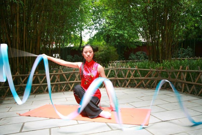 Art gymnastics. Chinese young woman display art gymnastics royalty free stock photo