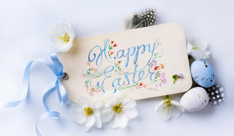 Art Happy Easter Background; Spring flowers, holidays card and e. Happy Easter Background; Spring flowers, holidays card and easter eggs stock photo