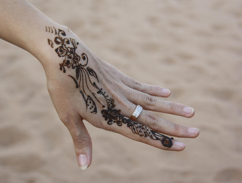 Art of henna paint on hand stock image