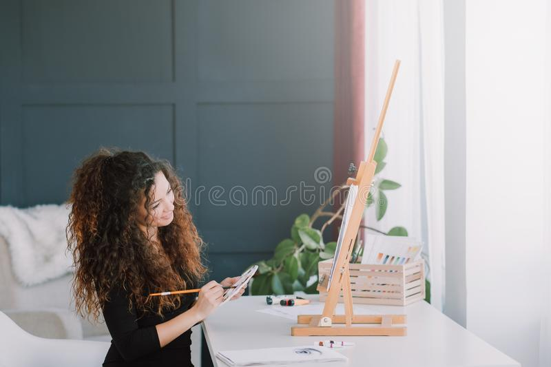 Art hobby creative lady painting home studio stock images