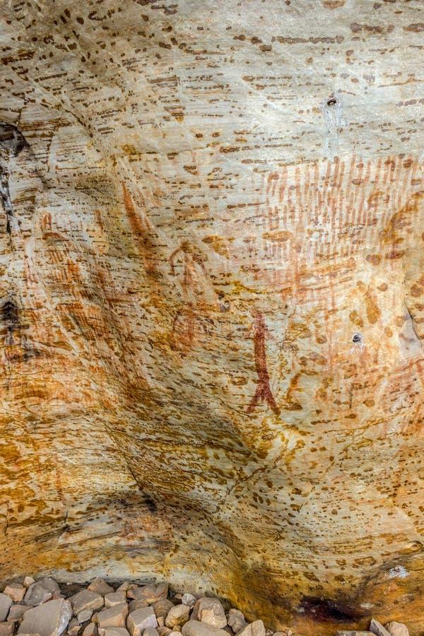 Art indigène antique : copies de main, troupeaux animaux, spirale, australie photos libres de droits