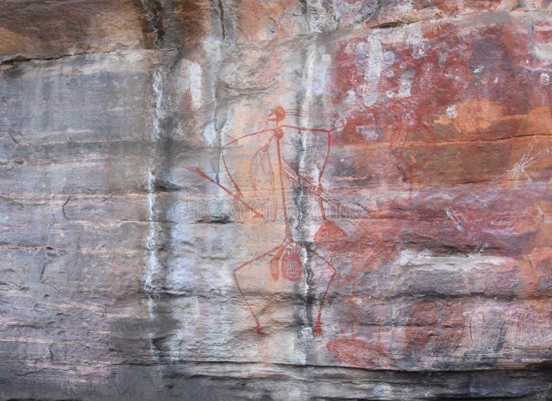 Art indigène sur la roche photo stock