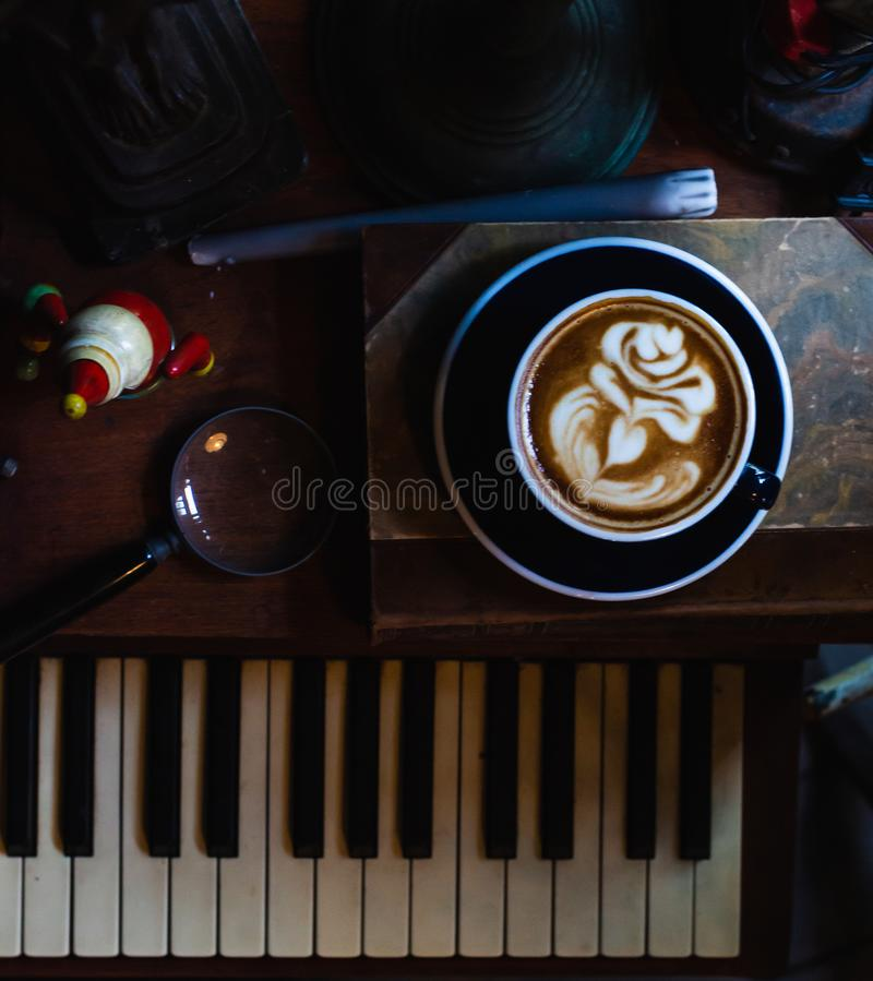 Art latte a cup of hot coffee on Piano royalty free stock photography