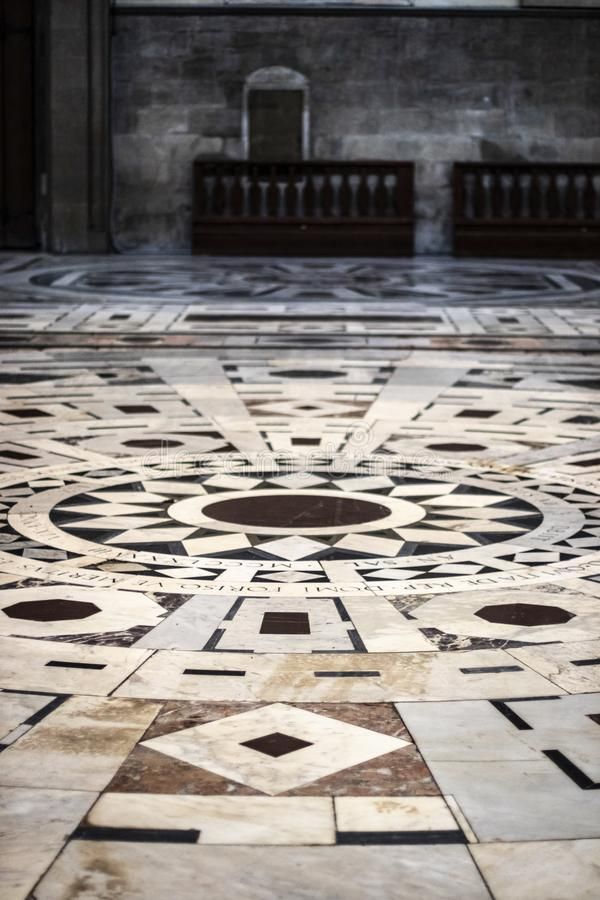 Art marble floor on circles inside a church royalty free stock images