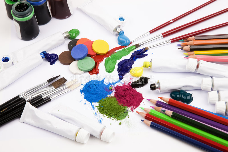 Art materials. Paint, brushes and coloured pencils royalty free stock image