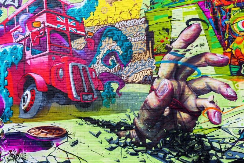 Art mural sur un mur dans la ville de Londres, R-U photo stock