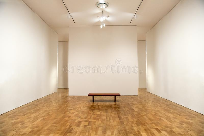 Art Museum, Blank Gallery Walls, Background. Art museum with blank walls and and gallery space. Nice background scene. Each wall is painted with an off white royalty free stock photo