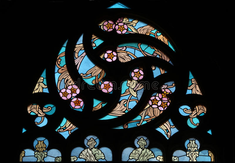 Art Nouveau floral pattern. Stained glass window. Art Nouveau floral pattern. Stained glass window in Saint Barbara Church in Kutna Hora, Czech Republic stock photo