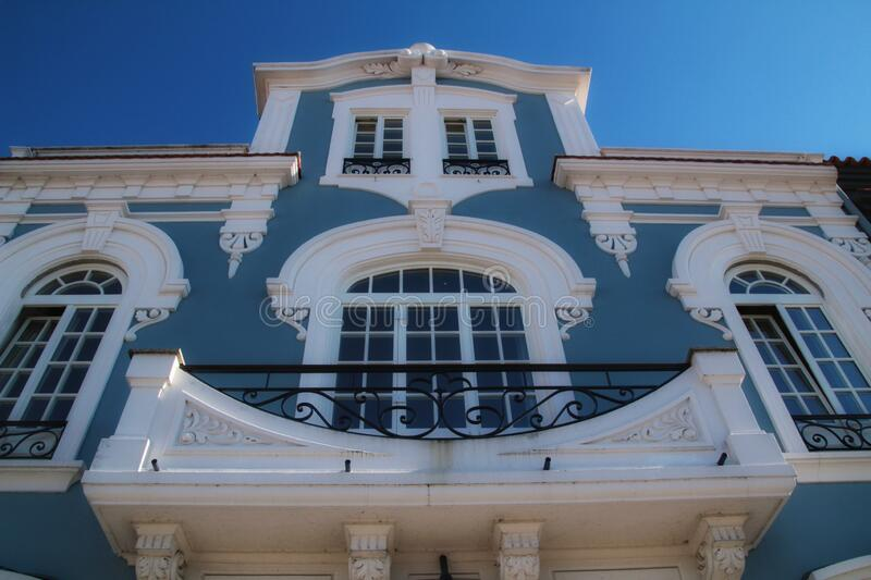 Art nouveau style facade next to the water canal in Aveiro village in Porto. Beautiful and old colorful typical facade next to the water canal in Aveiro village royalty free stock photography