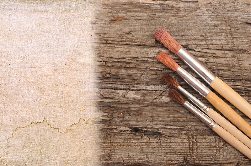 Art paint brush. On wood and canvas with space for text or image royalty free stock photo