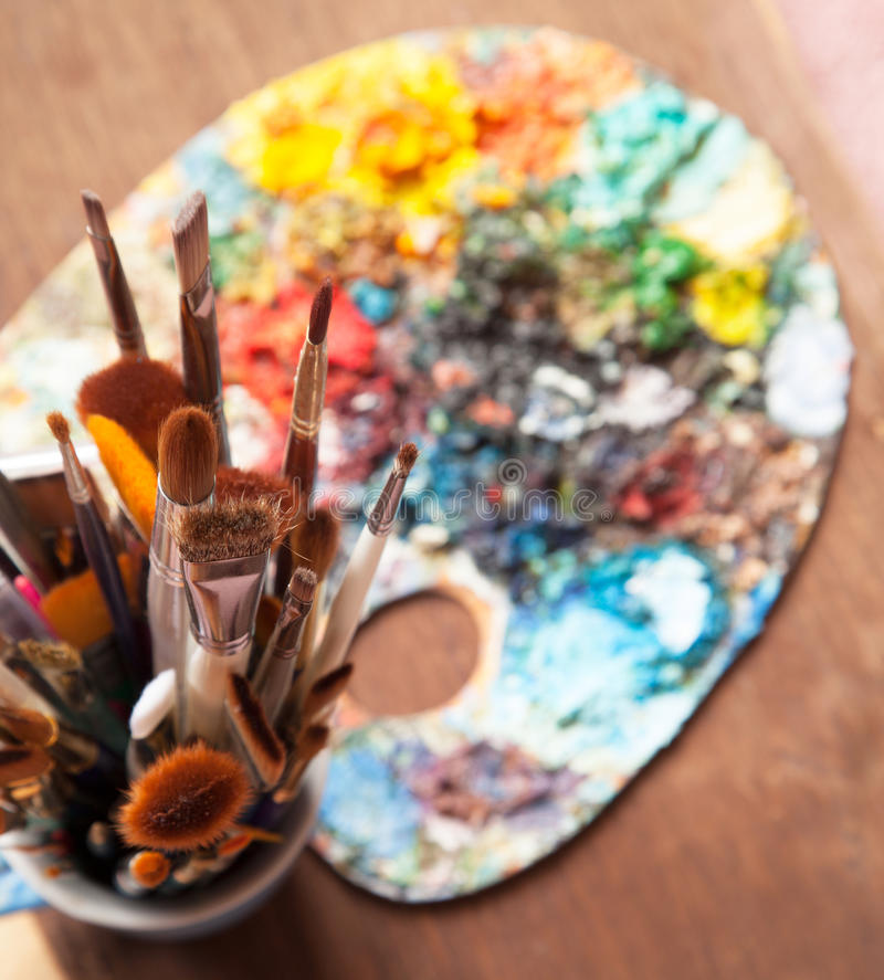 Art Paint Brushes and Palette. Focus on brushes royalty free stock photography