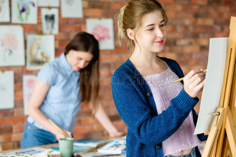 Art painting hobby girl drawing picture workshop. Art painting hobby. creative leisure. girl drawing a picture on easel in a workshop. talent inspiration stock photos