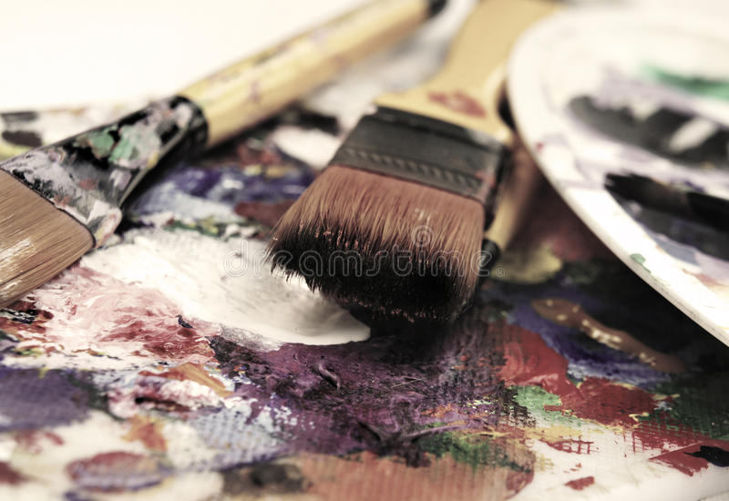 Art palette. And brushes with a lot of colors stock photo