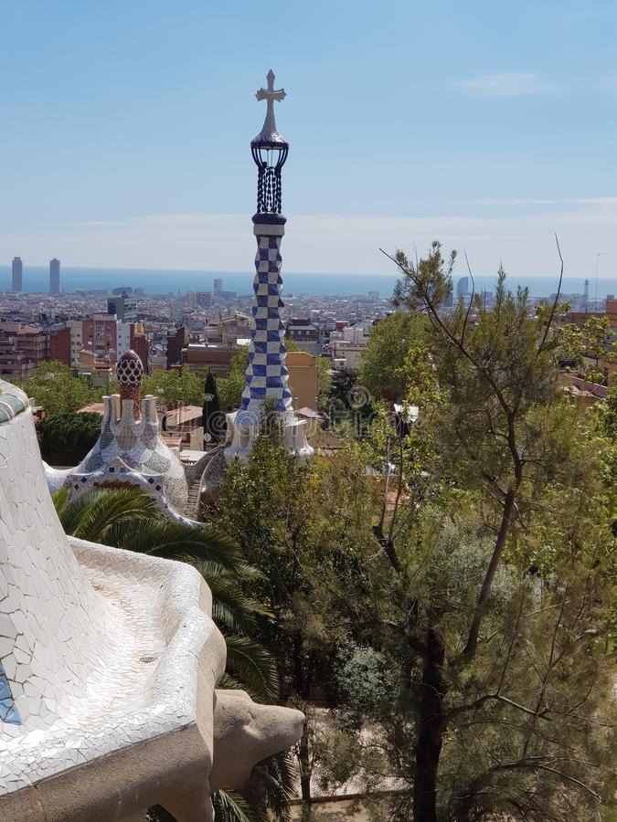 Art in Park Guell, Barcelona,Spain. Gaudis, barcelonaspain, tourism, tourists, day, arcade, palm, trees, architects, stone, ceramics, shape, bank, pieces, tile stock images