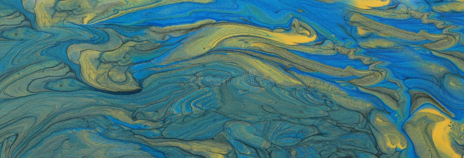 Art photography of abstract marbleized effect background. blue and gold creative colors. Beautiful paint.  stock photo