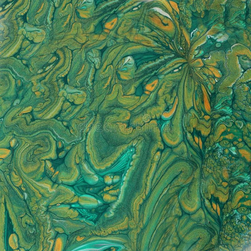 Art photography of abstract marbleized effect background. emerald green, turquoise and gold creative colors. Beautiful paint.  stock image