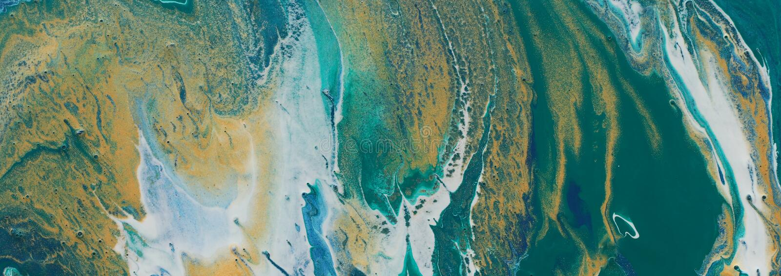 Art photography of abstract marbleized effect background. turquoise, emerald green, blue and gold creative colors. Beautiful paint royalty free stock images