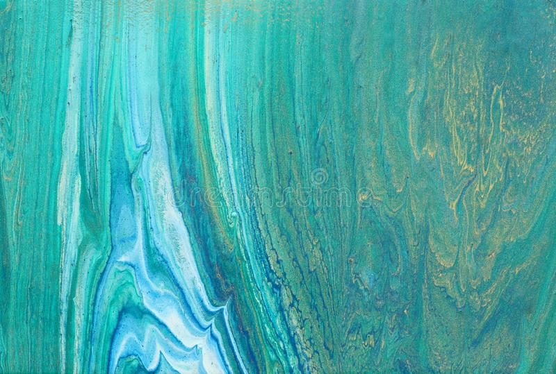 Art photography of abstract marbleized effect background. turquoise, emerald green, blue and gold creative colors. Beautiful paint.  stock photography