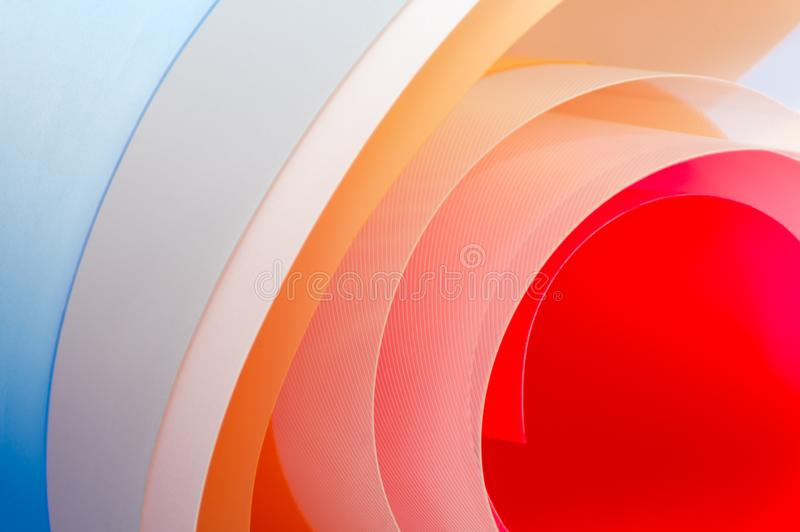 Art photography - background of multi-colored glossy sheets.  royalty free illustration