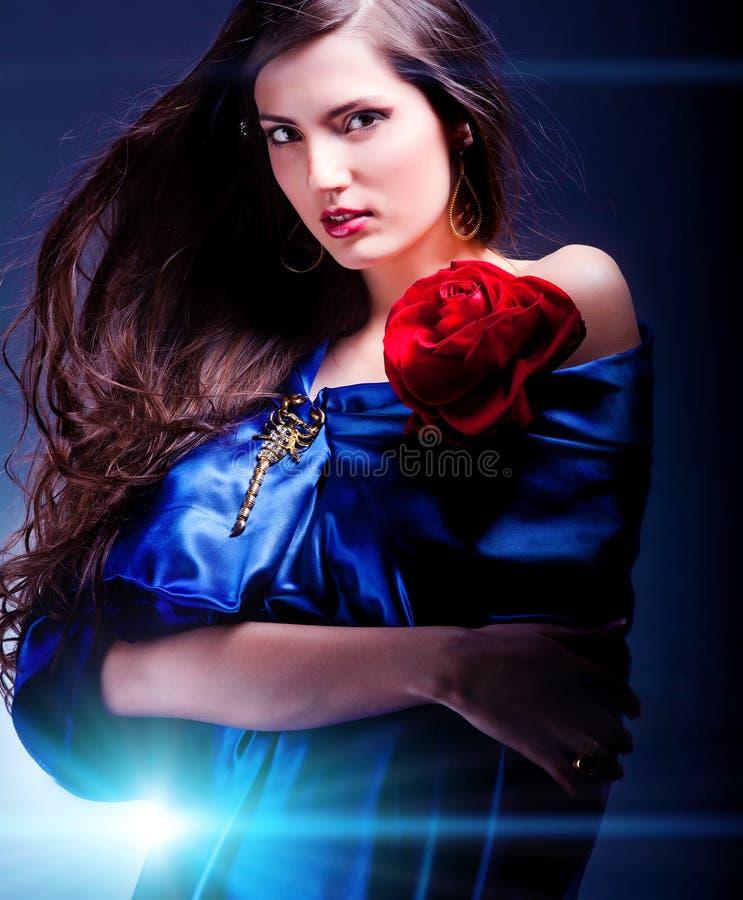 Art portrait of a beautiful woman in blue dress stock photos