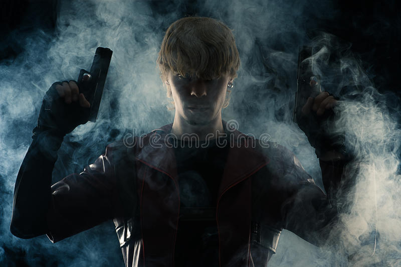 Art portrait man with two pistols in hands stock photos
