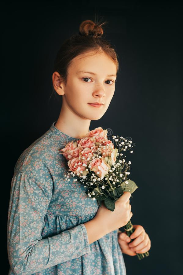 Pretty young girl wth soft bouquet of pink roses stock photography