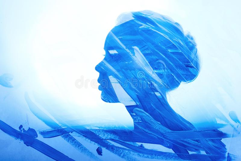 Art Portrait woman consisting of brush strokes of blue paint on a white background. Paint on girl face, fashion beauty and makeup stock photos