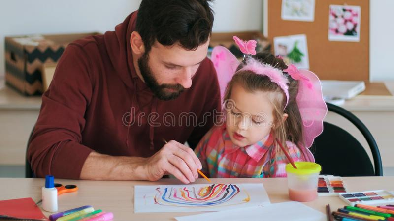 Art school teacher child pupil education royalty free stock photography